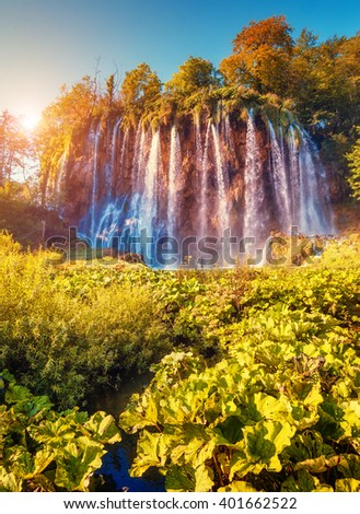 Majestic view on turquoise water and sunny beams.  Location famous resort Plitvice Lakes National Park, Croatia, Europe. Dramatic and vivid scene. Beauty world. Retro filter. Instagram toning effect. - stock photo