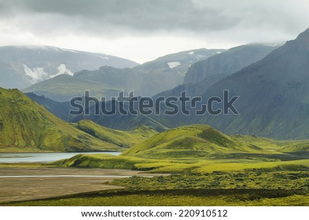 Majestic volcanic landscape covered with moss in Iceland highlands - stock photo