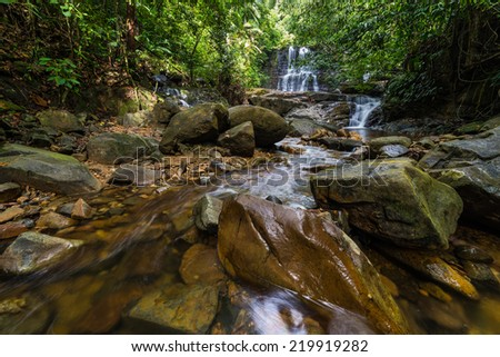 Majestic waterfall in the dense rainforest of Kubah National Park, West Sarawak, Borneo, Malaysia. - stock photo