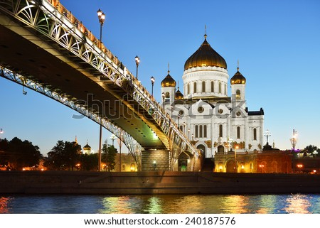 Majestic white orthodox Cathedral of Christ Saviour illuminated at dusk on bank of Moscow river, Moscow, Russia. It is tallest Orthodox church in world - stock photo