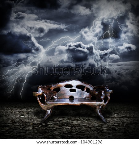 Majestic wooden throne standing on the abandoned land during a storm - stock photo