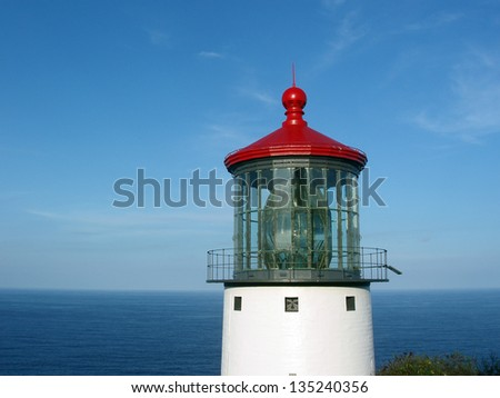 Makap'uu Point Light (Makapu'u Lighthouse) on the island of Oahu with view of Pacific Ocean.  It has the largest lens of any lighthouse in the United States. - stock photo