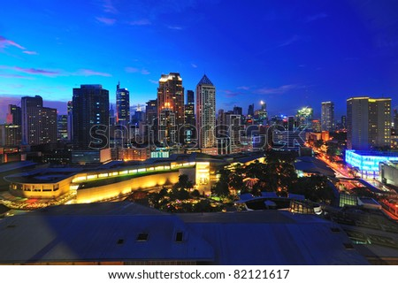 Makati city in twilight, Philippines - stock photo