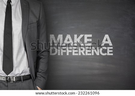 Make a difference on black blackboard with businessman - stock photo