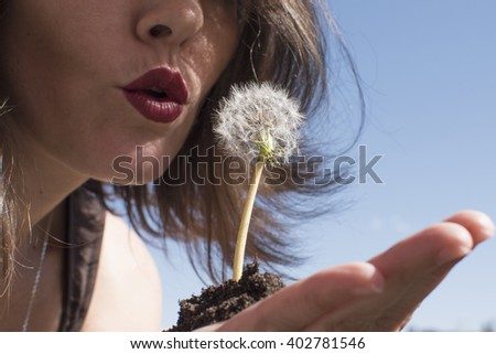 Make a wish. Blowing a dandelion