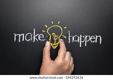 Make idea happen concept, hand taking light bulb between words written by chalk - stock photo