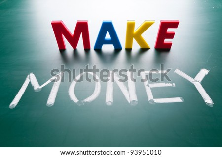 Make money concept, message words on blackboard - stock photo