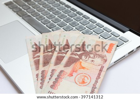 Make money with computer laptop, Laos currency, Kib  - stock photo