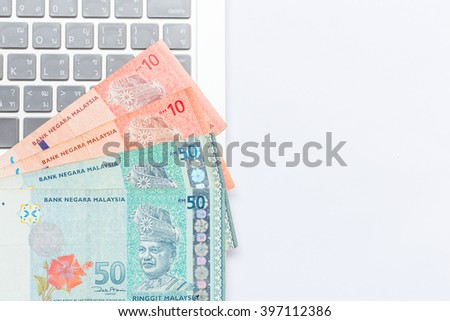 Make money with computer laptop, Malaysia currency, Ringgit  - stock photo