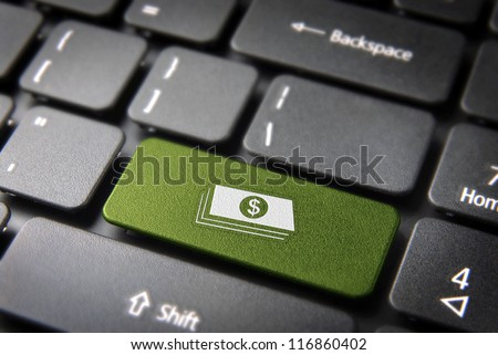 Make money with internet: green key with dollar bills icon on laptop keyboard. Included clipping path, so you can easily edit it. - stock photo
