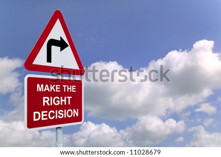 Make the Right Decision on a signpost against a blue cloudy sky. - stock photo
