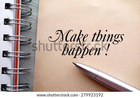 Make things happen text write on paper as background with pen and book - stock photo