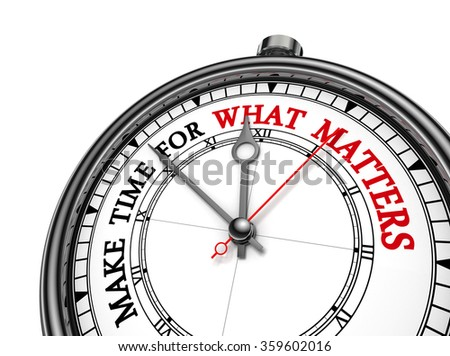 Make time for what matters motivation quote on concept clock, isolated on white background - stock photo