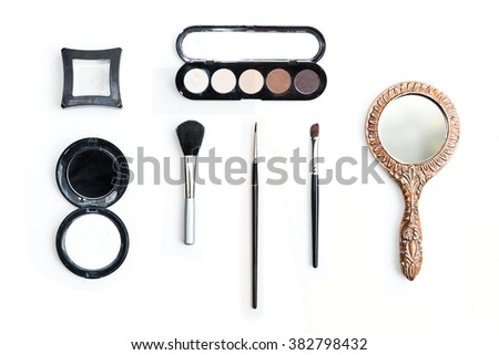 Make up and dresser items on white - stock photo