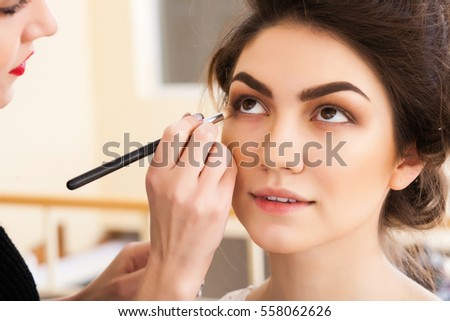 Attractive Make Up Artist Doing Make Up Beautiful Girl In The Salon, Beauty Concept Nice Design