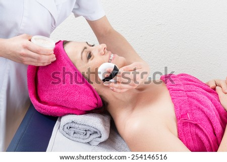 Make up artist doing professional make up of a woman