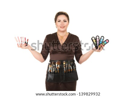 Make-up artist holding cosmetics in hands isolated on white background - stock photo