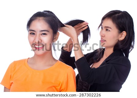 make-up artist was up to a woman on a white background. - stock photo