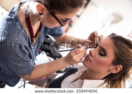 Make-up artist work in her studio. - stock photo
