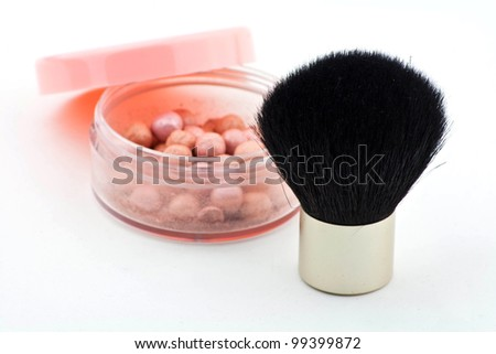 Make up Brush and pearl arranged on white background - stock photo