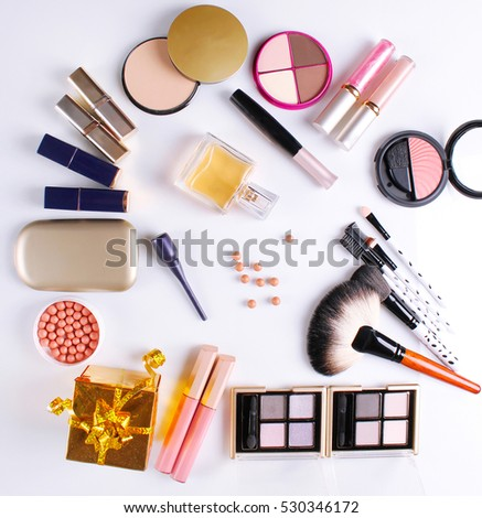 make-up brush, perfume, eye shadow, blush on the white background