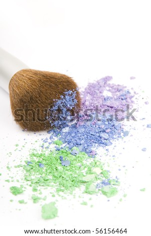 Make up brush with broken eyeshadows. - stock photo