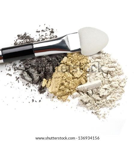 Make-up brush with colorful crushed eyeshadows - stock photo