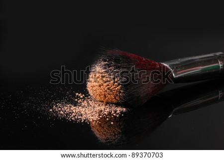Make up brush with powder isolated on black - stock photo