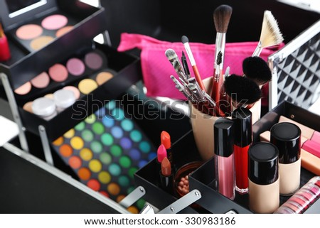 Make up case with cosmetics on a white background - stock photo
