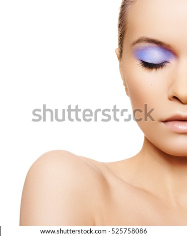 Make-up & cosmetics. Closeup portrait of beautiful woman model face with clean skin on white background. Natural skincare beauty, clean soft skin and bright eye makeup