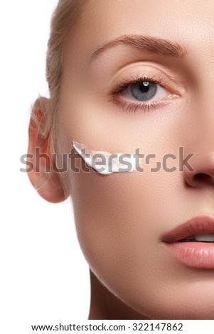 Make-up & cosmetics. Closeup portrait of beautiful woman model face with skin foundation on white background. Portrait of beautiful woman clean fresh skin. Skin care concept. - stock photo