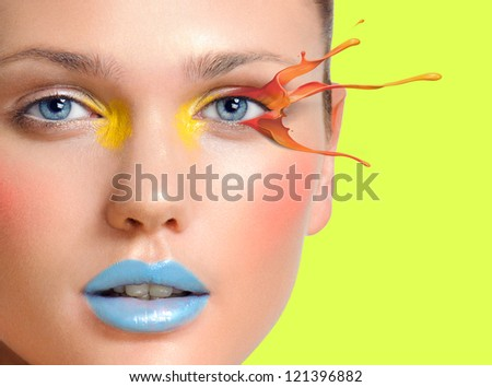 Make-up cosmetics, color splash, Closeup portrait of beautiful woman model face with clean skin on green background. Natural skincare beauty, clean soft skin - stock photo