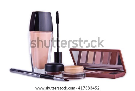 Make up essentials. Set of professional make up brushes, creams and shadows in jars on white background. Place for your text or logo. Ideal for beauty blog. Partly isolated with shadows.