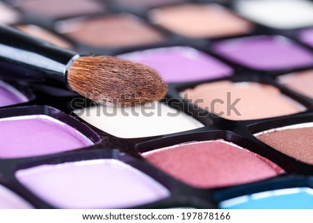 Make-up eye shadows palette with makeup brush, closeup - stock photo