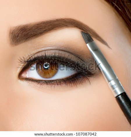 Make-up. Eyebrow Makeup.Brown Eyes - stock photo