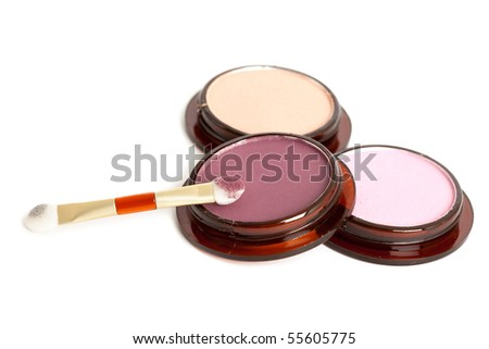 make-up eyeshadows and cosmetic brush - stock photo