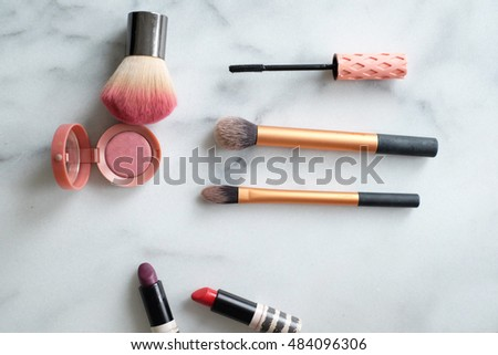Make up flat lay on marble table