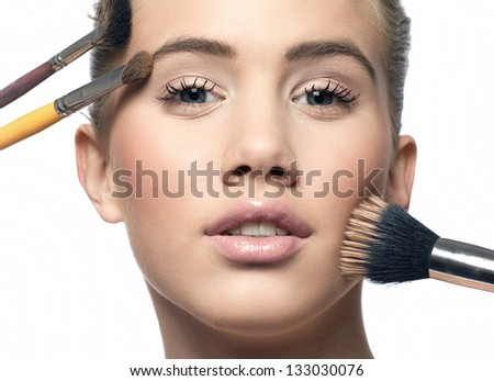 Make-up girl, woman teenager face with make up brushes and a blusher - stock photo