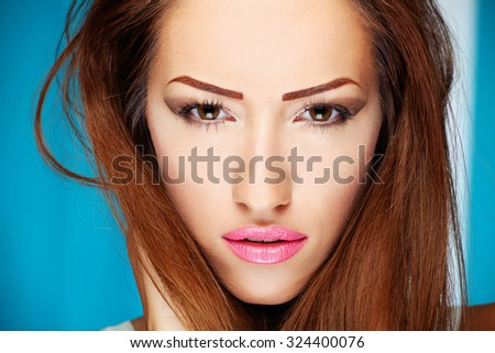 Make up on brunette woman - stock photo