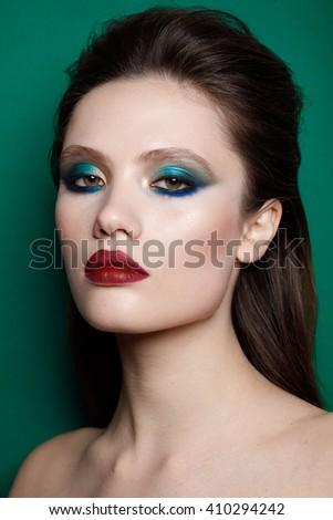 Make up on fashion model. Eyelashes extensions. Perfect Make-up closeup. Foundation. Cosmetic Eyeshadows, eyebrows. Beauty Girl with Perfect Skin. Eyelashes. Makeover - stock photo