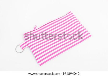 Make up pink bag on white background - stock photo