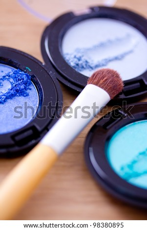 make-up shot of some blue eyeshadows and brush
