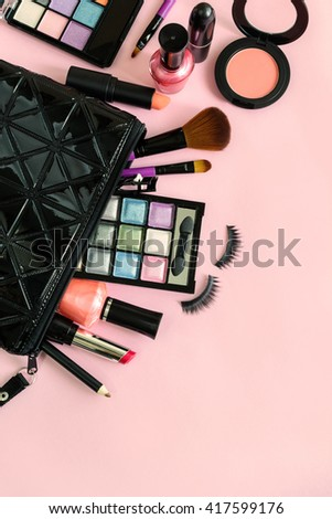 make up with cosmetics and brushes isolated on pink background with copy space - stock photo