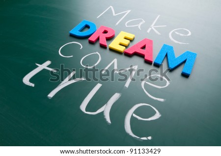 Make your dream come true. Colorful words on blackboard.