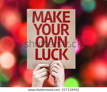 Make Your Own Luck card with colorful background with defocused lights - stock photo
