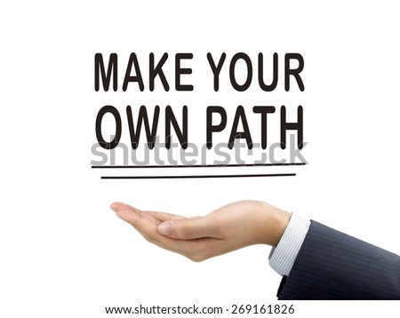 make your own path words holding by businessman's hand over white background - stock photo