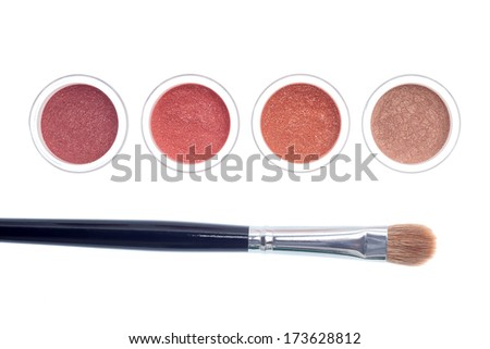 Makeup and brush isolated on white background - stock photo