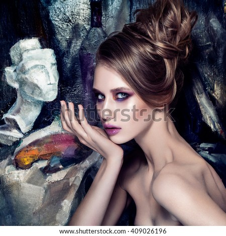 Makeup art and beautiful model theme: beautiful girl on creative art background in the studio. Muse of art