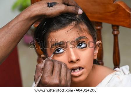 Makeup artist applies eye shadow young stock photo 484314208 makeup artist applies eye shadow for young indian girlwomenkidchild wearing publicscrutiny Image collections