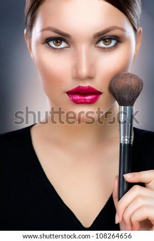 Makeup.Beautiful Woman Applying Make-up - stock photo